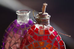 Decorative bottle lamps. Decorated glass bottles transformed into oil lamps Stock Photo