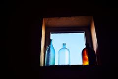 Decorative bottle on the window Royalty Free Stock Photos
