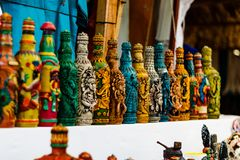 Decorative bottles on a shelf in Puerto Quetzal, Guatemala. stock photography