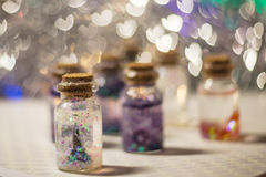Decorative bottles with sparkles Stock Images