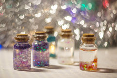 Decorative bottles with sparkles Stock Photos