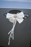 Decorative bow on car handle for wedding decor Royalty Free Stock Photo