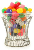 Decorative Bowl of Jelly Beans. Colorful jelly beans in decorative glass jar over white Royalty Free Stock Photos