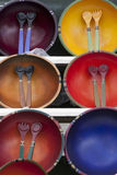 Decorative Bowls and Flatware for Sale. Decorative bowls and flatware are on display for sale at a market. Vertical shot Stock Photos