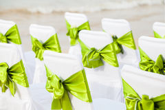 Decorative Bows on a Row of Chairs Royalty Free Stock Photography