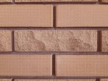 Decorative brick, for facades. Stone texture. Pale brown background. Close-up.  stock image