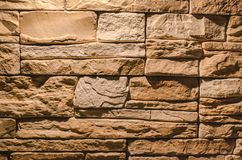 Decorative brick wall background. Textured brick wall abstract background with copy space in the light of lamp Royalty Free Stock Image