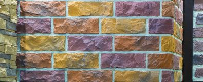 Decorative brick wall from concrete facing tiles as background or texture Stock Photo