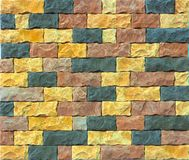 Decorative brick wall from concrete facing tiles as background or texture Stock Photos
