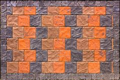 Decorative brick wall from concrete facing tiles as background or texture Royalty Free Stock Image
