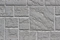 Decorative brick gray wall close up as a background or texture. Stock Photos