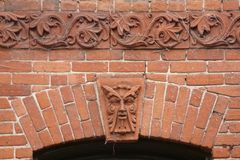 Decorative Brickwork with Face Royalty Free Stock Photo