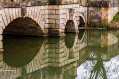 Decorative Bridgestone With Keystones Over The Water. Horizontal photography Stock Images