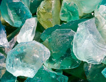 Decorative broken green glass stones. Macro of broken glass stones used for outside decor Royalty Free Stock Images