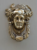 A decorative Bronze Door Handle, Malta. An old style decorative bronze door handles in the form of a beautiful woman`s head, the distinctive feature of Malta Stock Photography