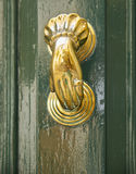 A decorative Bronze Door Handle, Malta. An old style decorative bronze door handles in the form of a woman`s hand, the distinctive feature of Malta Royalty Free Stock Photography