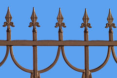 Decorative bronze fence isolated on blue Royalty Free Stock Photography