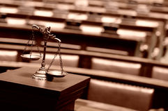 Decorative bronze Scales of Justice in the Courtroom Stock Photos