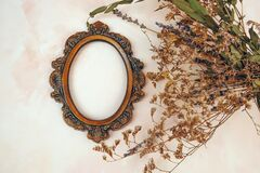 Free Decorative Bronze Vintage Oval Photo Frame And Dried Flowers. Royalty Free Stock Photo - 171712995