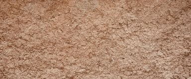 Decorative Brown Colored Grained Cement Plaster Wall Wide Backgr Stock Photos