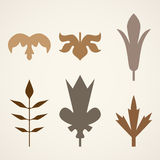 Decorative brown leaves pattern set isolated on white .. Various shapes of brown leaves. Elements for eco and bio logos Royalty Free Stock Images
