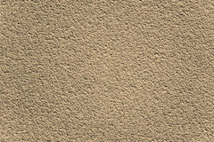 Decorative brown textured rugged plaster wall Stock Image