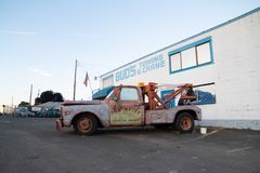 Decorative brown truck with `tow mater` on it stock images