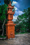 Decorative Buddhist lamp. Outdoors in a park or garden Stock Photo