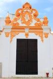 Decorative building and wooden door Stock Photo