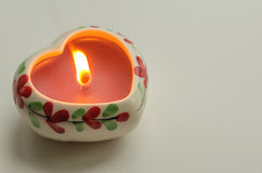 Decorative burning candle in the shape of a heart Stock Photo