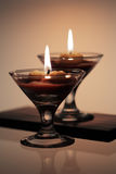 Decorative burning candles. In candlesticks as wine-glasses Royalty Free Stock Photo