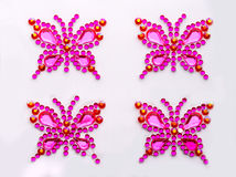 Decorative butterflies. Butterfly symbols made of decorative gems isolated Royalty Free Stock Photos