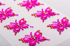 Decorative butterflies. Butterfly symbols made of decorative gems macro Stock Images