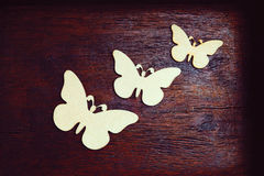 Decorative butterflies. On a vintage wooden background Stock Image