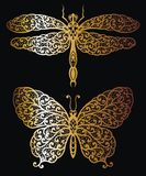 Butterfly and Dragonfly in gold Stock Images