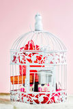 Decorative cage with Christmas gifts inside. Stock Photo