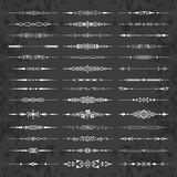 Decorative calligraphic dividers on a chalkboard background- vector set for design and page decoration Stock Photos