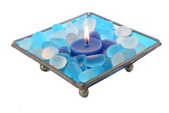 Decorative candle. With blue and white decorative stones isolated over white Stock Photo