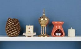 Decorative candles on white shelf Royalty Free Stock Photos