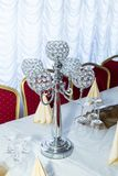 Decorative candlestick on the festively decorated table Royalty Free Stock Photography
