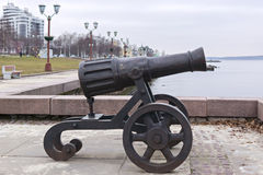 Decorative cannon on city lake quay Royalty Free Stock Images