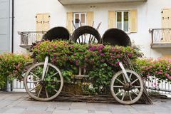Decorative car with flowers in street Levico Termen, Italy stock images