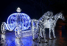 Decorative carriage with horses decorated with lights Stock Image
