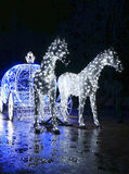 Decorative carriage with horses decorated with lights Royalty Free Stock Photos