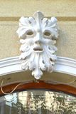Decorative carved face on building facade Royalty Free Stock Images