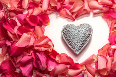 Decorative carved heart in heart shape of red rose petals. Decorative carved heart in heart frame shape of red rose petals Royalty Free Stock Photo