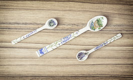 Decorative carved spoons on the wooden background Stock Images