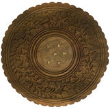 Decorative carved table top isolated. Decorative carved and inlaid circular indian table top isolated stock photo