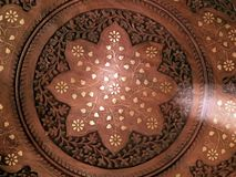 Decorative carvings on the board. Close-up Stock Image