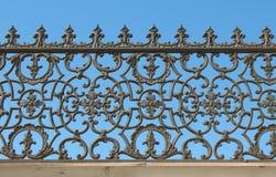 Decorative cast-iron fence. Background Stock Image